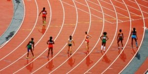 A group of track runners lined up to begin a race
